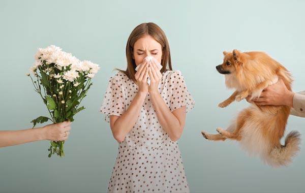 Image having an unkown allergic reaction to flowers or dog